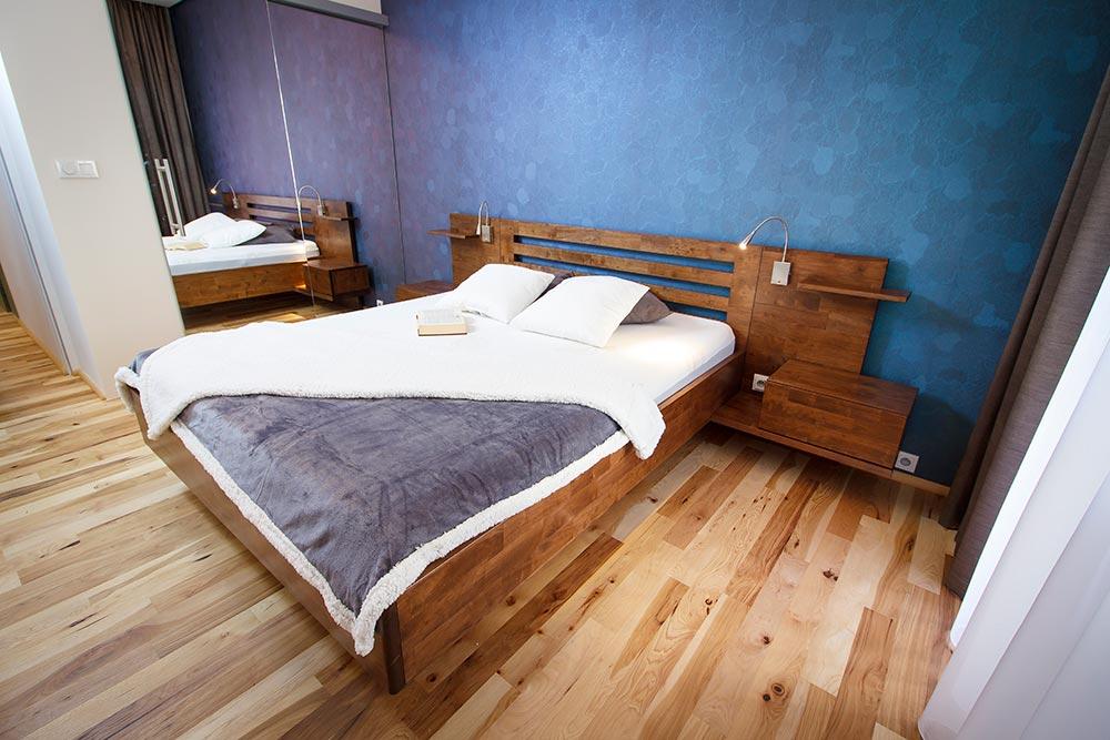 Zakázkově vyráběná masivní postel AMELIA.